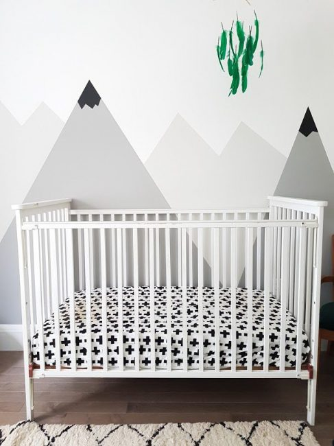 Cute bedroom idea - nursery with a hand painted mountain mural