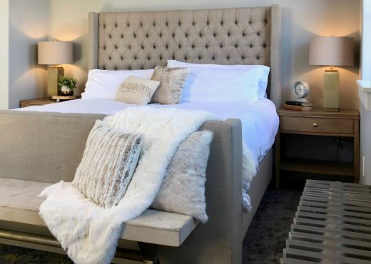 Staged neutral bedroom with cosy textured accents
