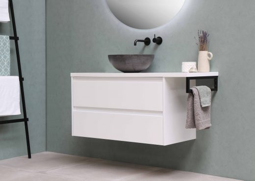 wall mounted sink and bathroom cabinet keeping floors clear.