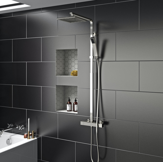 sleek tiled bathroom with tiled niches in the shower area for bottles etc.